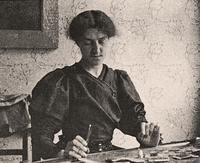 Photograph of May Morris with embroidery